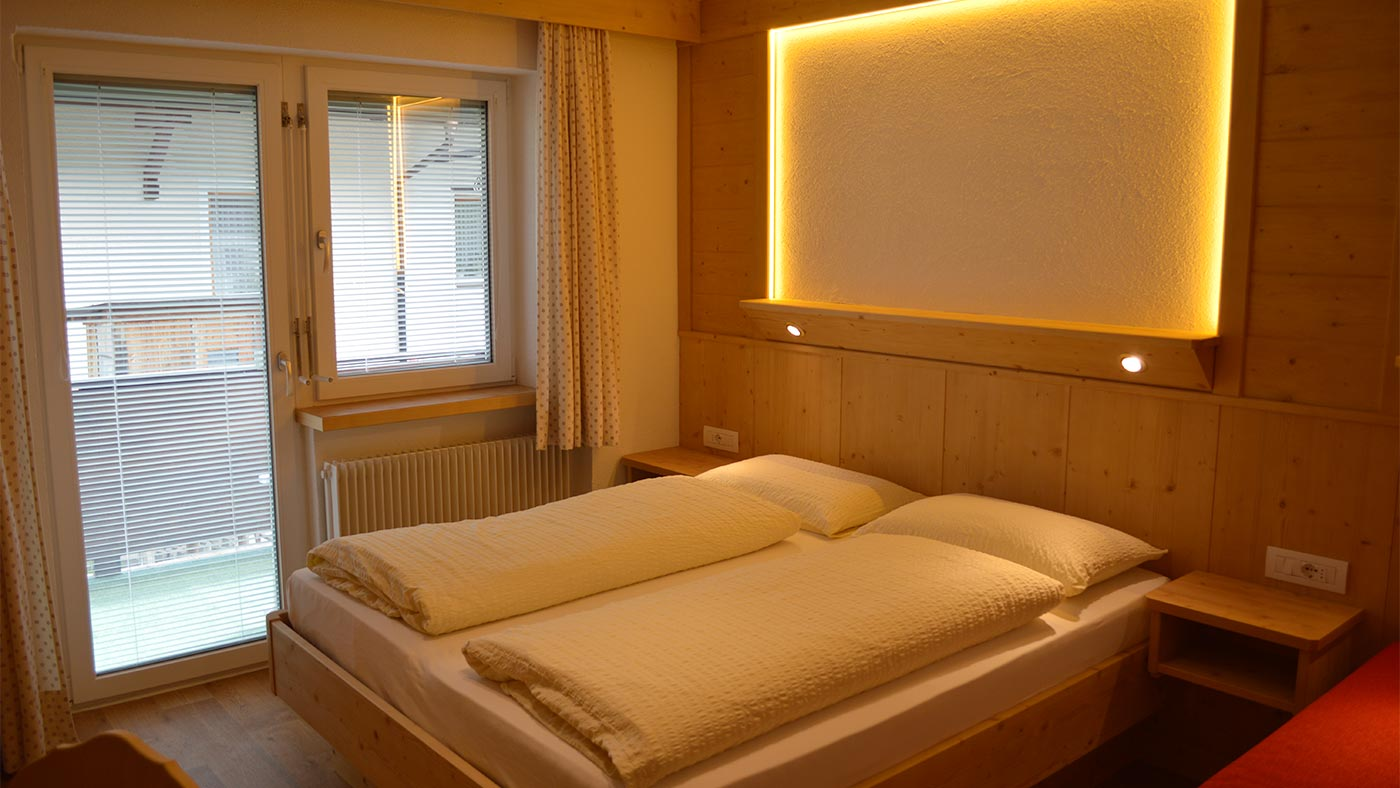 The comfortable double bed in an apartment of the Residence Edelweiss in San Candido